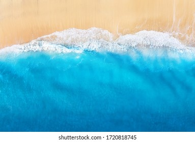 Coast with waves as a background from top view. Blue water background from drone. Summer seascape from air. Travel - image - Shutterstock ID 1720818745