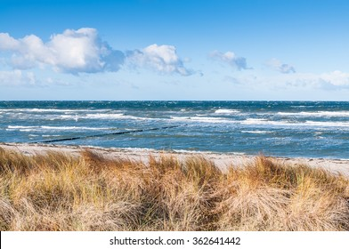 Coastal area at Mecklenburg-Western Pomerania; Coastal scenery with sandy beach, dunes with marram grass and rough sea on winter day