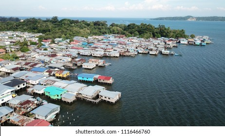 Coastal Asian fishing town. Poor slum town at risk from climate change and rising sea levels.