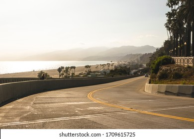 Coastal avenue overlooking the beach and ocean in Santa Monica. Palms and hills in California. Beautiful landscape.