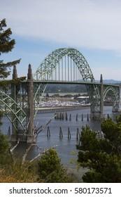 Coastal Bridge Over Ocean Waters with Boat Docks in Background