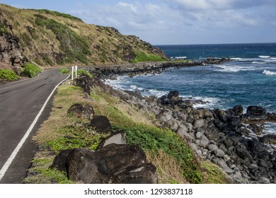 Coastal Byway in Hawaii:  A narrow road passes close to the edge of a lava rock coast in the Hawaiian Islands.
