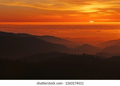 Coastal Californa Sunset over Mountains and Foggy Pacific Ocean