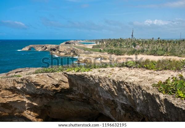 coastal cliffs and beaches of punta las tunas at cueva del indio along puerto rico's north coast