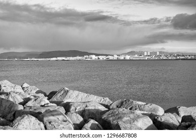 Coastal defence and fortification. Stony breakwater in sea. Breakwater surround docks, ports and lagoons. Breakwater function concept. Breakwater scandinavian seascape. Pier sea fortification.