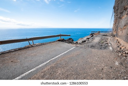 Coastal Erosion. The devestating effects of coastal erosion on a road in the Canary Island of Gran Canaria illustrating what environmental damage is possible from a fragile overhanging cliff face.