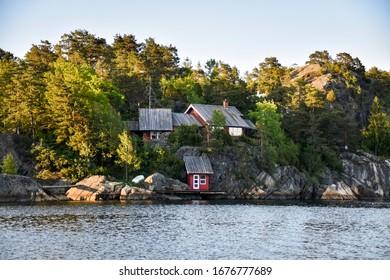 Coastal fishermen houses in a bay of Norway