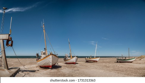 Coastal fishing boats on the beach at SletteStrand at the North Sea in Denmark