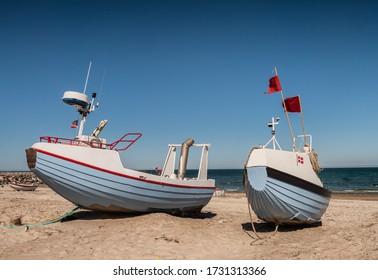 Coastal fishing boats on the beach at Kloitmoeller Strand at the North Sea in Denmark