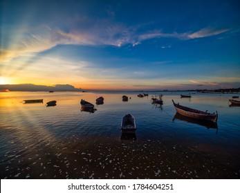 Coastal fishing boats are waiting water tide on sunset at the Bang sean's bay , Thailand.