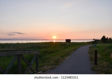 Coastal footpath by sunset at the swedish island Oland with the Oland Bridge in the background