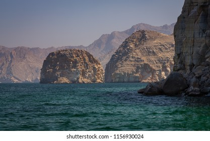 Coastal Khasab Scenery in Oman. Beautiful coastal scenery near Khasab, in Musandam peninsula, Oman, photo taken from a boat during a tour.