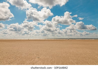 Coastal landscape with blue cloudy sky on summers day. Dutch north sea. IJmuiden. The Netherlands. Seascape.