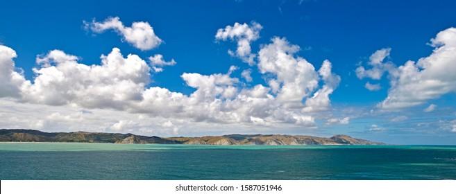 Coastal landscape with cumulus clouds, near Mahia, Mahia Peninsula, Hawkes Bay Region, North Island, New Zealand