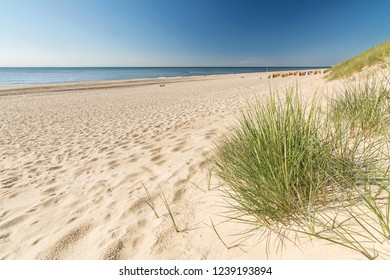Coastal landscape with dunes, beach and ocean
