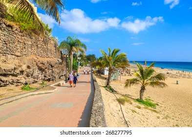 Coastal promenade along sandy beach in Morro Jable town, Fuerteventura, Canary Islands, Spain