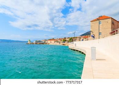 Coastal promenade along sea in Bol port with typical town architecture, Brac island, Croatia