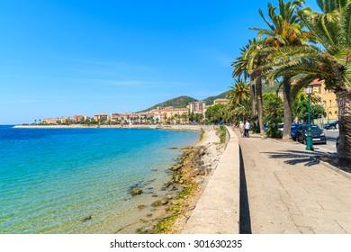 Coastal promenade with palm trees in Ajaccio town, Corsica island, France