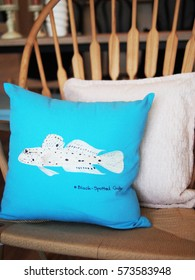 Coastal prop blue pillow.fish draw painting on blue cushion.decoration white and blue tone color.wooden armchair