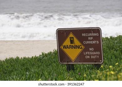 """Coastal """"rip currents"""" sign, California"""