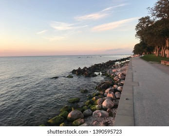 Coastal road corridor, beautiful view during sunset  Light hits the ground and the sky in Gotland, Sweden
