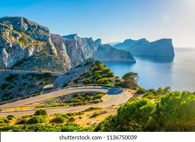 A coastal road winding through Mallorca towards Far formentor lighthouse, Spain