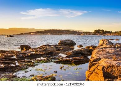 Coastal rocks in Arousa Island at the evening