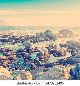 Coastal rocks and mountains with ocean horizon with retro style filter effect
