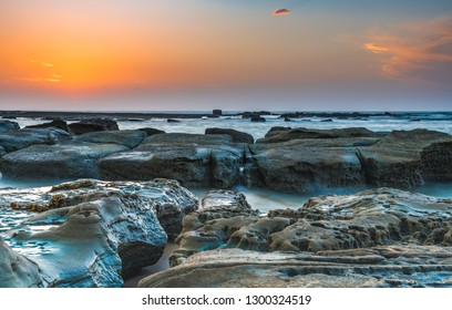 Coastal Rocky Sunrise -  Soldiers Beach in Norah Head, Wyong on the Central Coast, NSW, Australia.