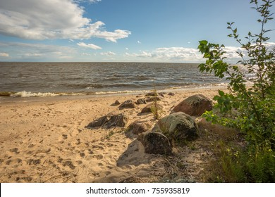 Coastal summer landscape with clouds. Pskov Lake, Russia.