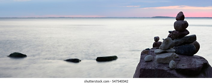 Coastal Sunset, Balancing Stones on the Baltic Sea, Rugen Island, Germany