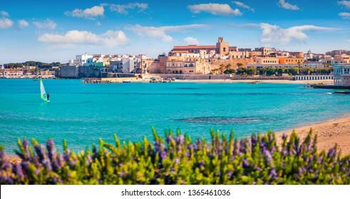 Coastal town in southern Italy's Apulia region - Otranto, Apulia region, Italy, europe. Splendid spring view of Alimini Beach. Traveling concept background.