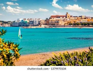 Coastal town in southern Italy's Apulia region - Otranto, Apulia region, Italy, europe. Sunny spring view of Alimini Beach. Traveling concept background.