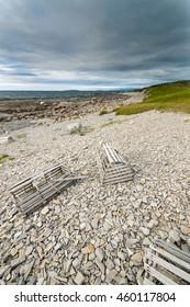 Coastal Trail | Gros Morne | Newfoundland  Crab pots abandoned on the beach near a popular walking track in Gros Morne National Park, Newfoundland, Canada.