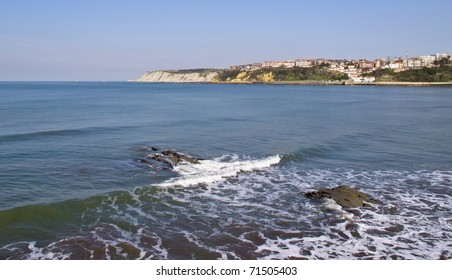 Coastal view with a city background