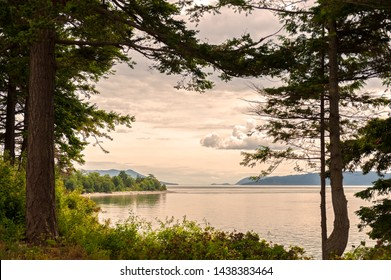 Coastal View of Lummi Island With Orcas Island in the Background. Located in the Salish Sea and situated in the northwest corner of Washington state.