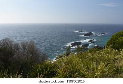 Coastal view and rocks viewed from Sugarloaf Lighthouse at Seal Rocks (NSW, Australia). Waves crashing into rocks.
