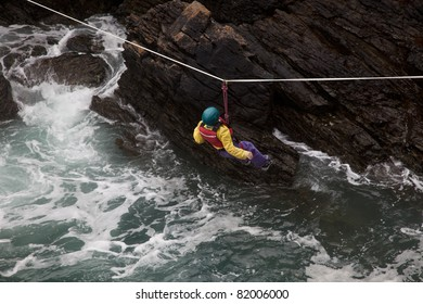 Coasteerers crossing across a gully