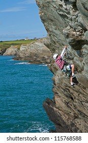 Coasteerers in the sea off Porthdafarch Isle of Anglesey North Wales UK