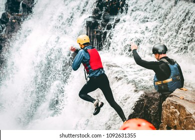 Coasteering - cliff, waterfall jumping in Brecon Beacons Wales, UK