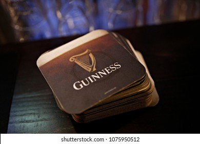 Coasters of Guinness beer in bar in Brussels, Belgium on April 24, 2018