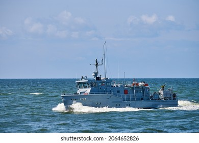 Coastguard, rescue and support patrol boat for defense sailing in blue sea. Navy patrol vessel protecting water borders and fisheries. Military ship, warship, battleship. Baltic Fleet, Russian Navy