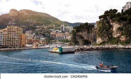 Coastguard rides boat along shoreline, accident prevention in swimming season