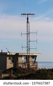 Coastguard Station at Hengistbury Head near Christchurch, Dorset, England with radio communications mast
