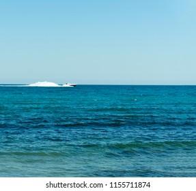 Coastguard white speed yacht in open waters