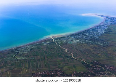 Coastline aerial view with contrasting colors between land and sea, Indonesia