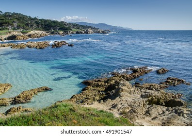 Coastline along the 17 Mile Drive in Pebble Beach of  Monterey Peninsula. USA. California. Large waves coming to rocks.