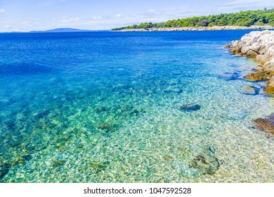 Coastline background picture of croatian beach island with crystal clear water.