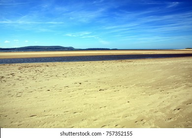 Coastline background of the sand beach at Burry Port Carmarthenshire Wales UK