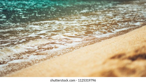 coastline beach on sunny day background of ocean and sky, gold sand blur, tourism relax calm concept, seascape perspective vacation, summer seashore on blue sea waves and sand at sunset, mockup